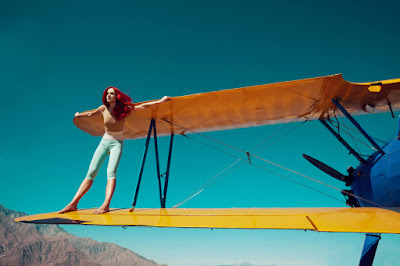 model on airplane wing, fashion shoot, woman at airport, woman on airplane, fashion photographer nyc