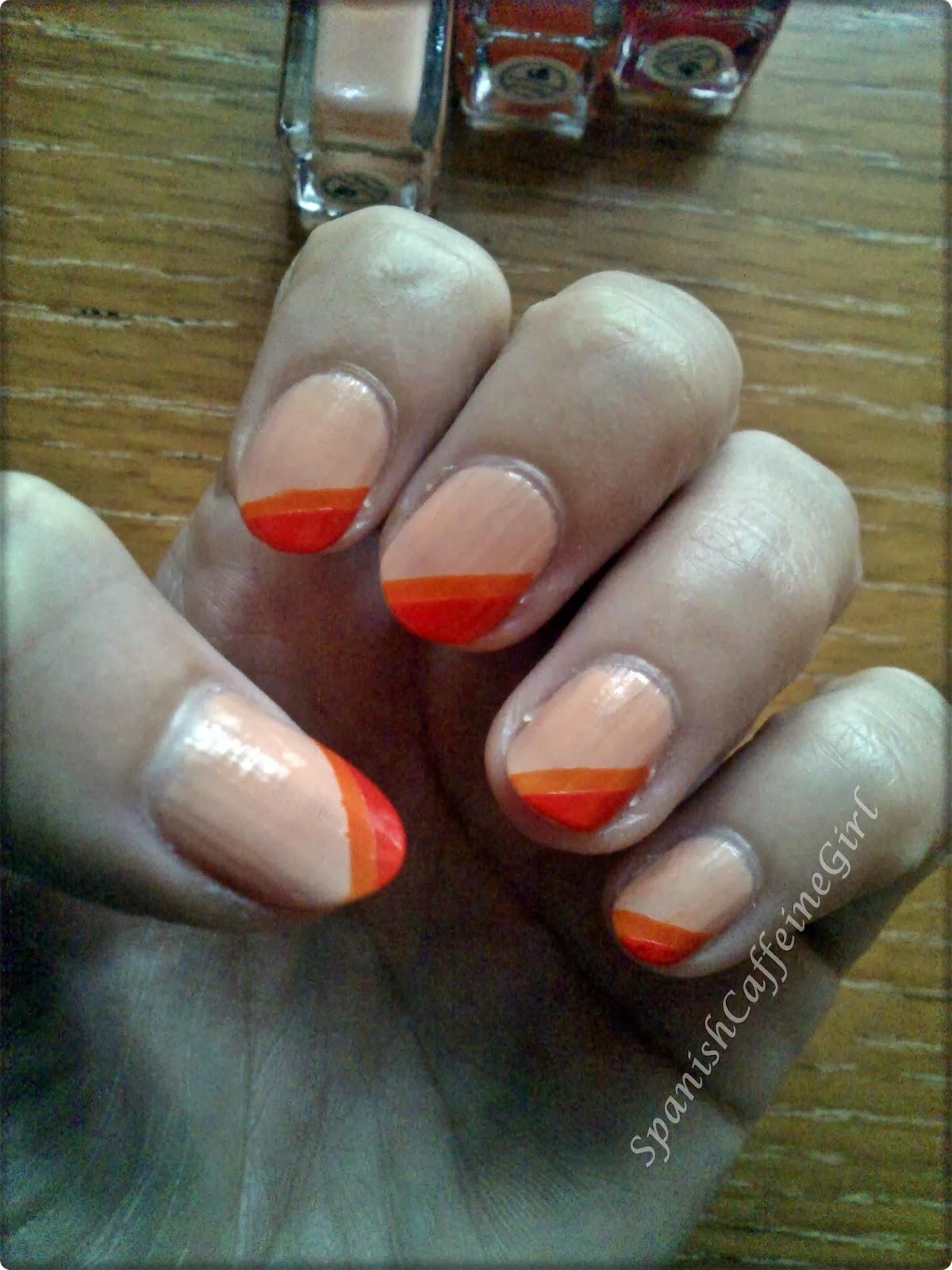 manicura con 3 tipos de color naranja
