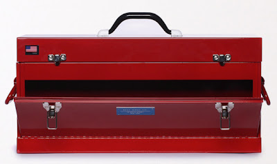 red metal toolbox with front-open drawer