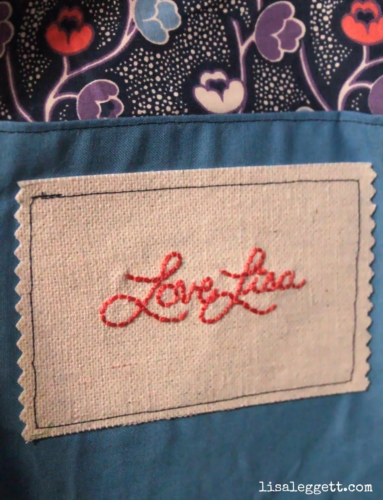 Hand stitched label on interior pocket