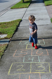 toddler running on a hopscotch board