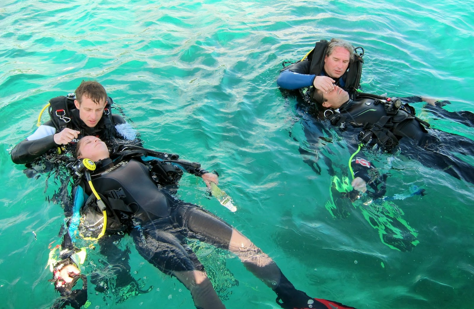 PADI Rescue students practising in water mouth to mouth resucitation in Malapascua, Philippines.