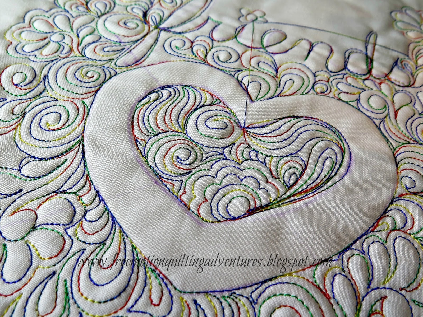 Heart free motion quilted