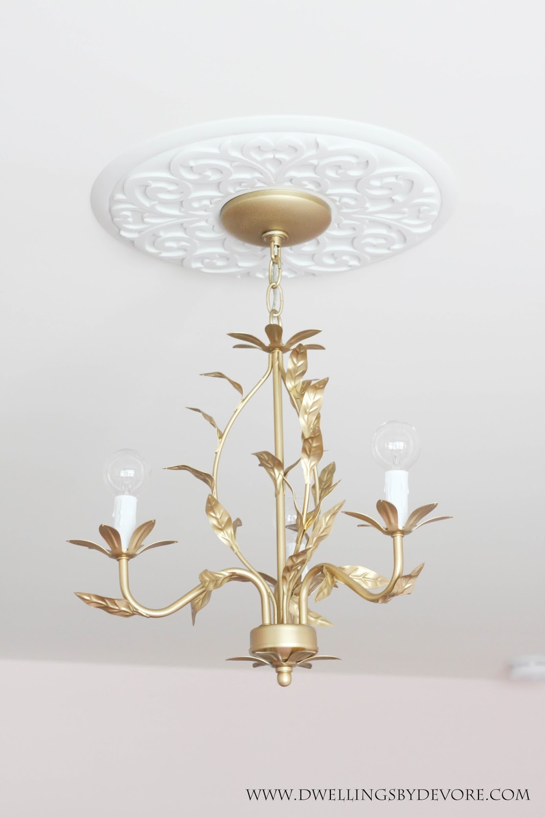 Dwellings by devore gold chandelier after seeing jennifers beautiful chandelier transformation i decided round bulbs would give it the perfect little modern touch i was looking for aloadofball Gallery
