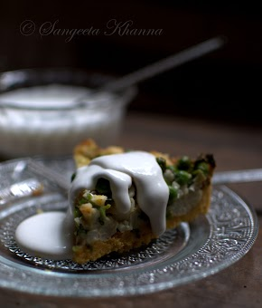 Gluten free quiche baked with Indian flavors | cornmeal, cauliflowers and green peas quiche with sour cream..