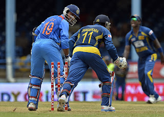 Dinesh-Karthik-Bowled-India-vs-Srilanka-Tri-Series-2013