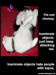 Image: cat on its back with its paws up in the air. Text: I'm not clumsy. Inanimate objects just keep attacking me. Inanimate objects hate people with lupus.