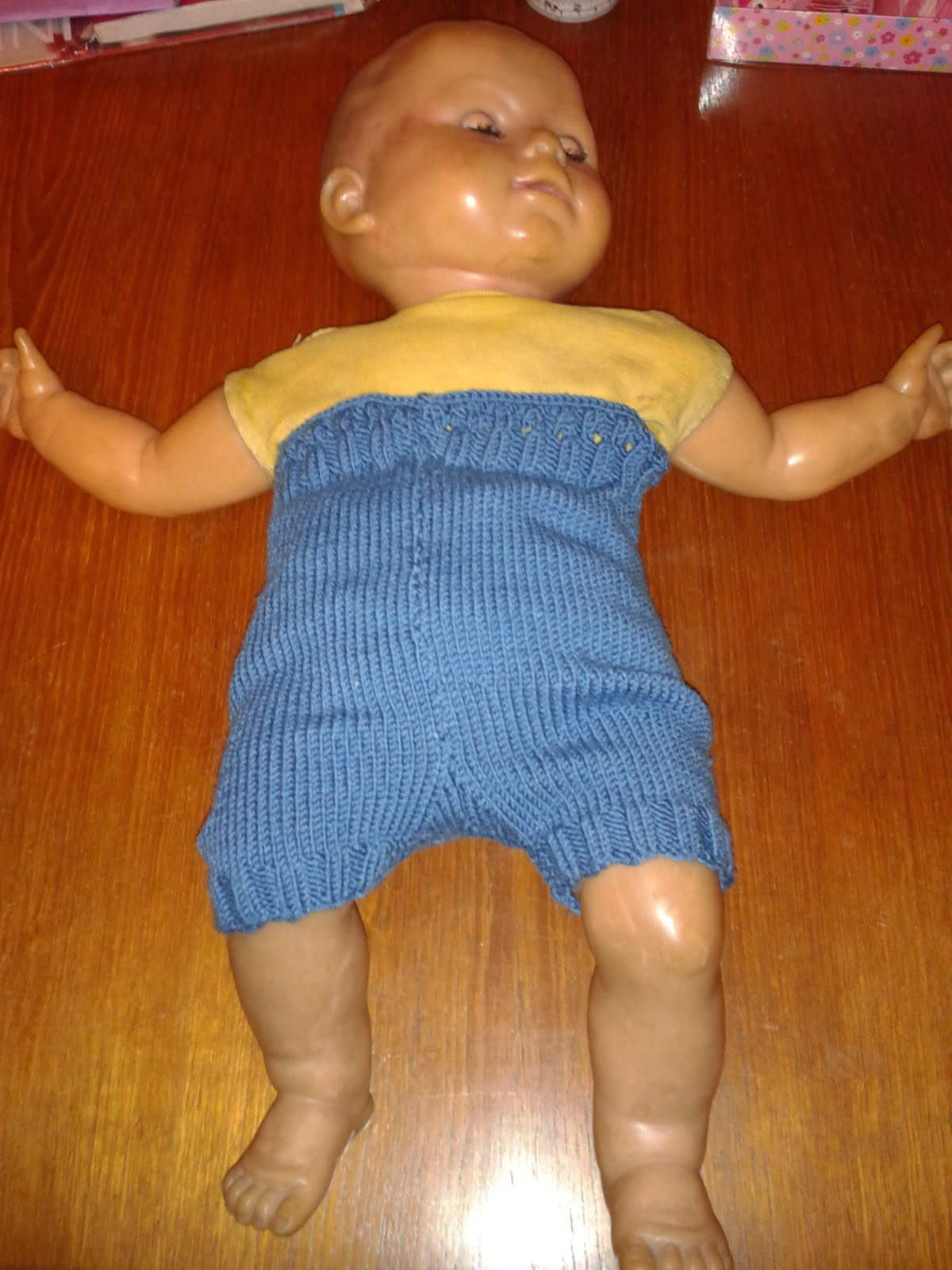 Blue knitted shorties, wool nappy cover on doll