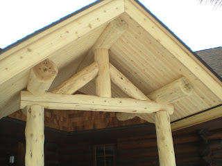 log roof support, covered entry, http://huismanconcepts.com/