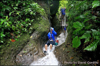 David Gordillo - Ziplining through a waterfall