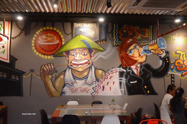 Interesting grafitti depicting the Thai people who dine after work
