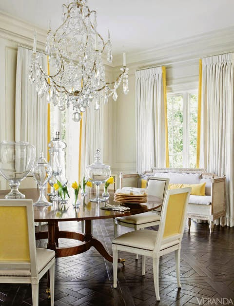 house beautiful in her dining room designer melanieturner alluded to a french ballroom fitting custom mirrors into carved wood wall panels and using a