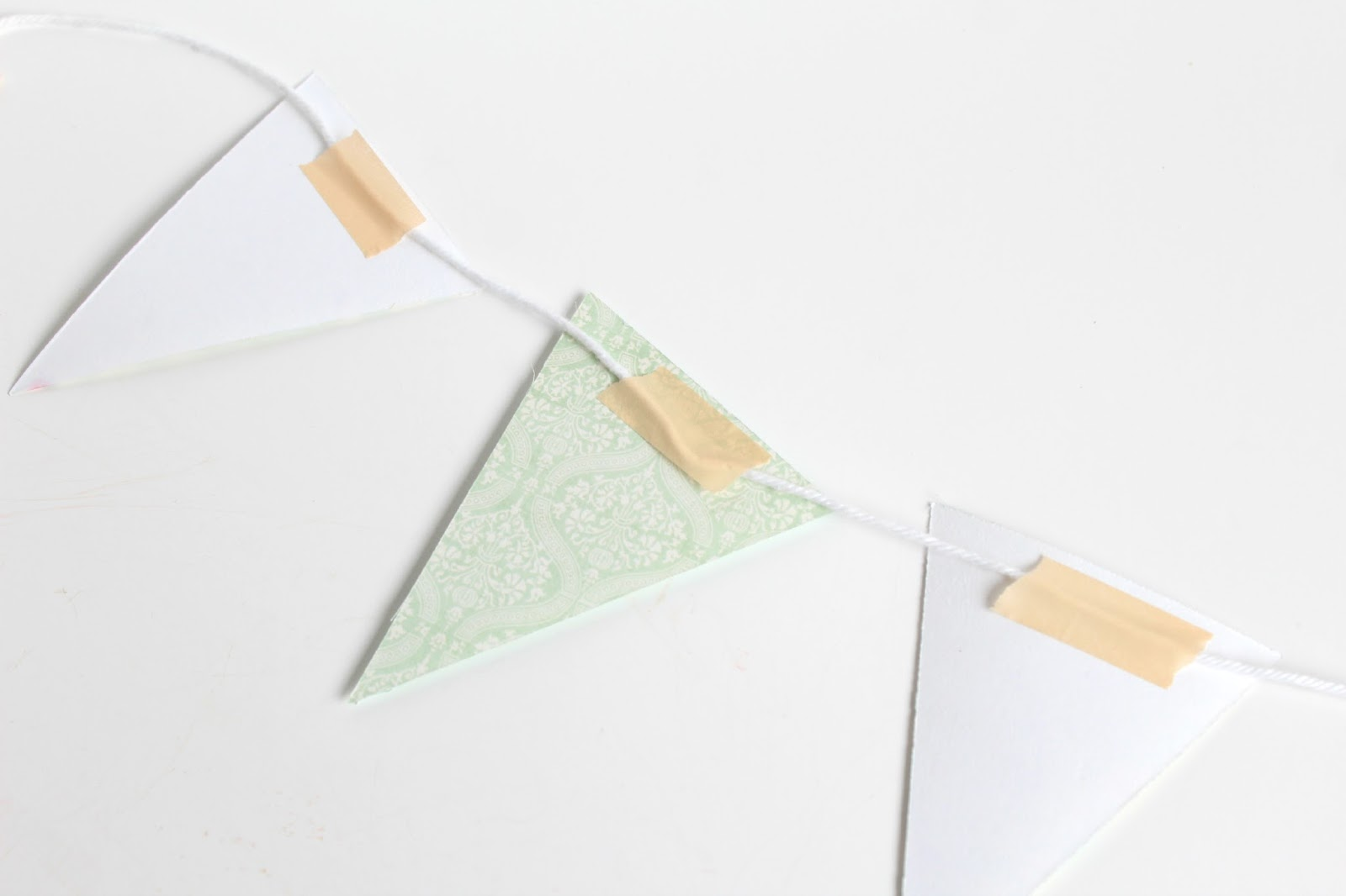 paper bunting Our custom bunting is made from various fabrics to suit your needs we also create custom shaped designs to make your bunting stand out.