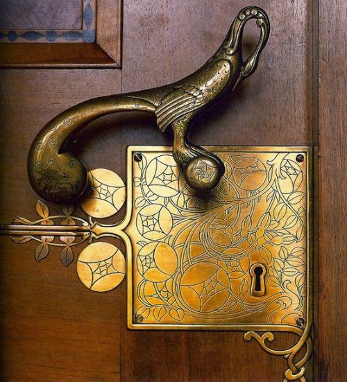 Engraved brass door lock with figural peacock door handle fabulous