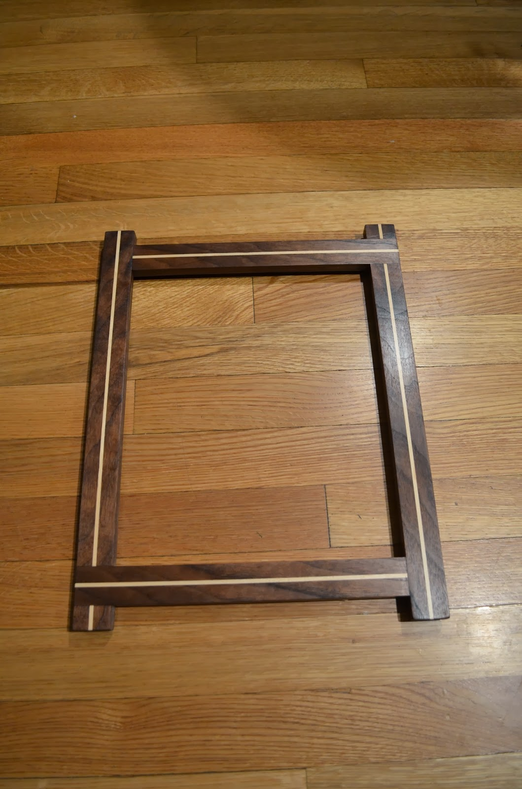 Picture frames vaughan woodworks the maple inlays pop out nicely over the walnut lap joints on all corners rotate for an circular overlapping effect thanks to rachel for the idea jeuxipadfo Image collections