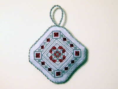 Scarlet and Gray Christmas Ornament, designed and stitched by Erin Turowski
