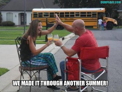 beginning of school year parents, parents high five in front of bus, back to school funny, back-to-school humor, funny back to school pictures, school bus, parents celebrate beginning of school