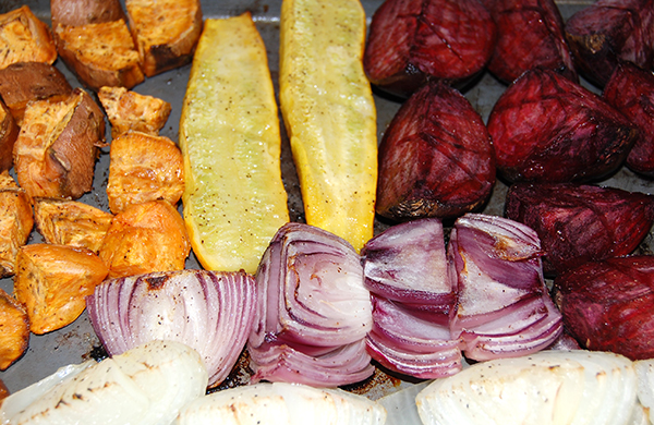 finished roasted yams, squash, beets, and onions