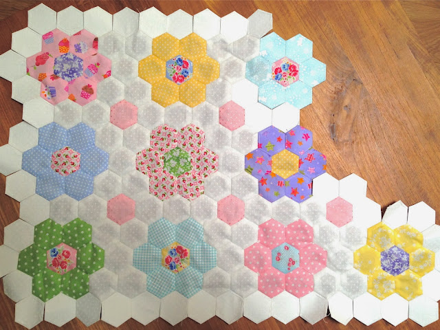 Hexagon quilt made from pink, green and aqua Lakehouse Dry Goods fabric