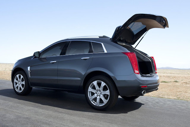 Rear 3/4 view of 2011 Cadillac SRX with hatch open