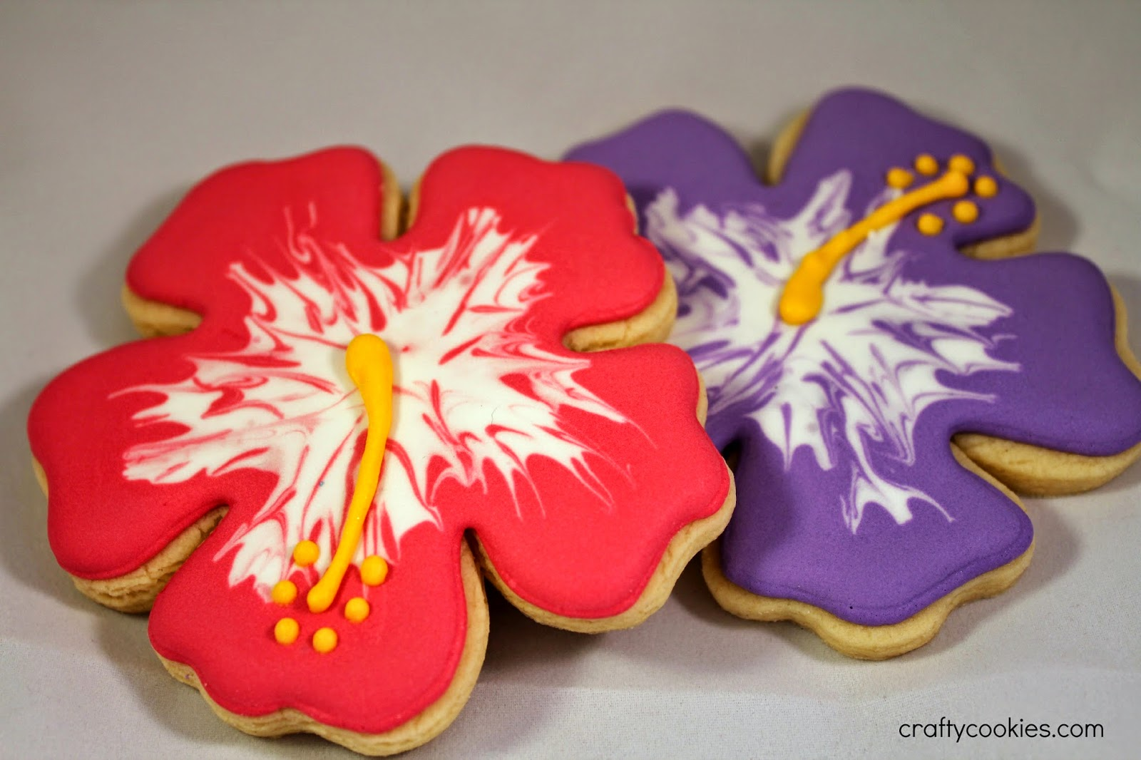 Crafty cookies easy hibiscus flower cookies but you can purchase a standard hibiscus cutter or use a large shamrock cookie cutter instead i outlined and flooded the cookies with the desired color izmirmasajfo