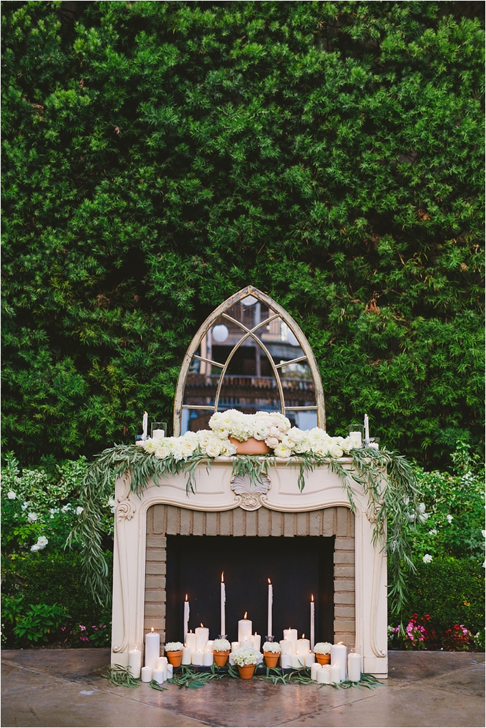Fireplace Ceremony Altar with flowers and candles via @thesocalbride