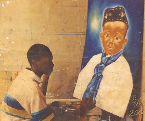 ayodeji painting at a very tender age