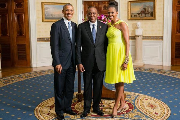 President Uhuru Kenyatta with President Barack Obama and First Lady Michelle Obama in the Blue Room of the White House on August 5, 2014. WHITE HOUSE PHOTO | AMANDA LUCIDON