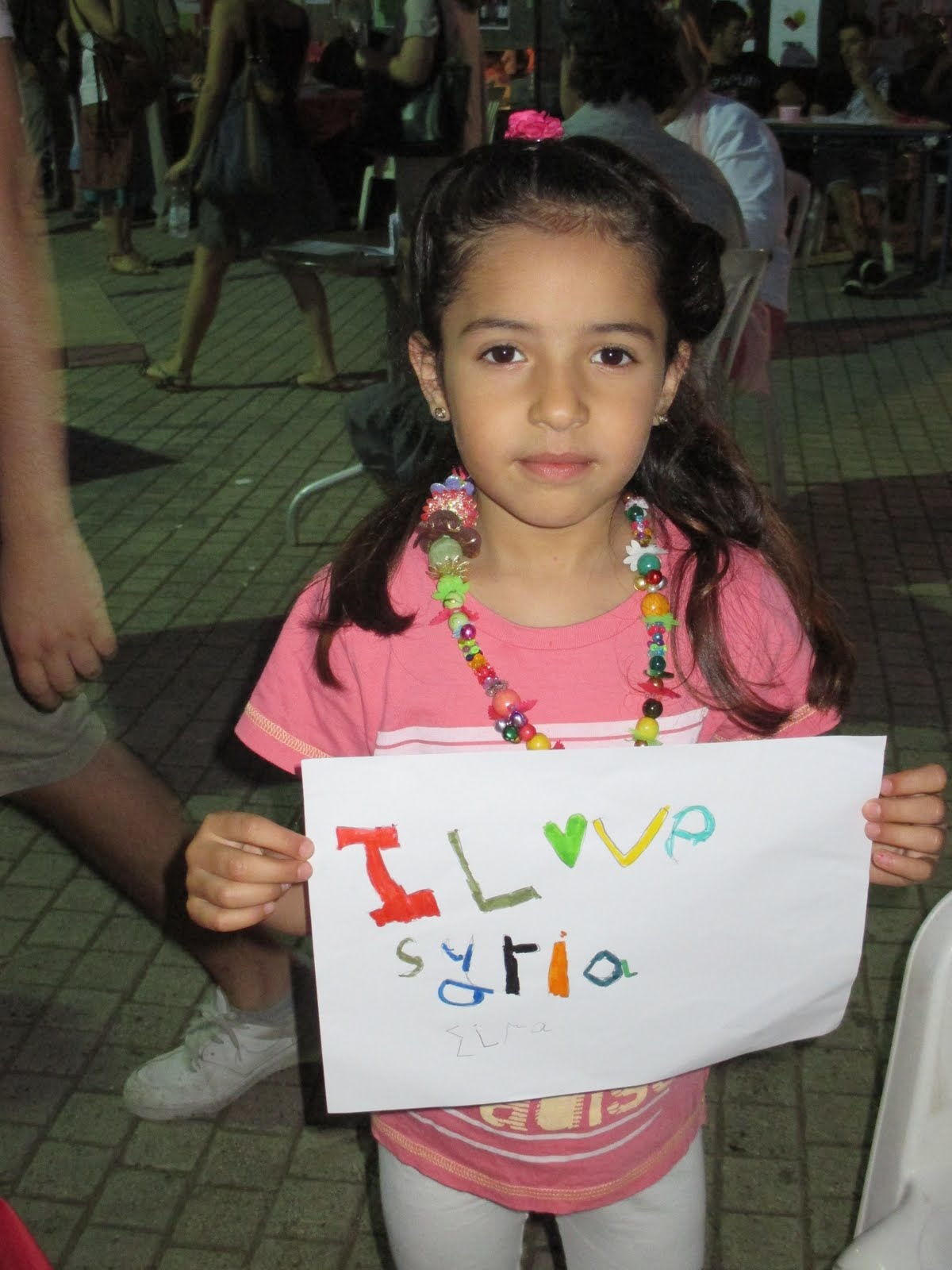 Syrian Refugee with a Sign She Made, Chania, Crete, June 2015