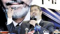 """وكالة أنباء الشرق الأدنى: """"مرسي"""" أزال ورمًا سرطانيًا من المخ ومريض بالقلب والكبد الوبائي"""
