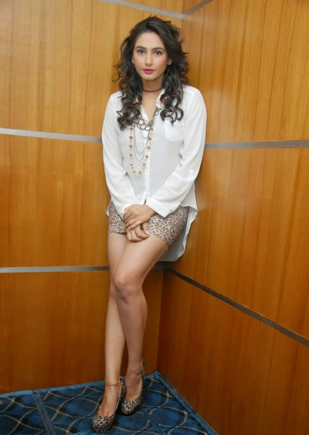 ragini dwivedi smiling photos shoot in white tops and short secrts