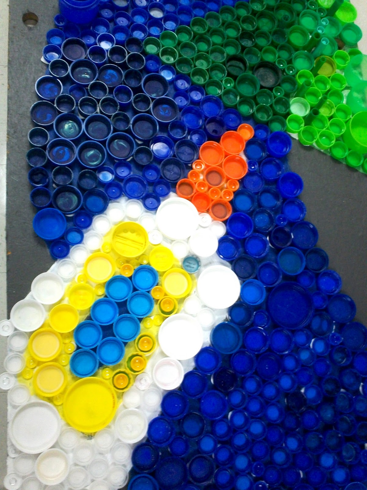 Art with mr e bottle cap mural in progress for Pictures of bottle caps