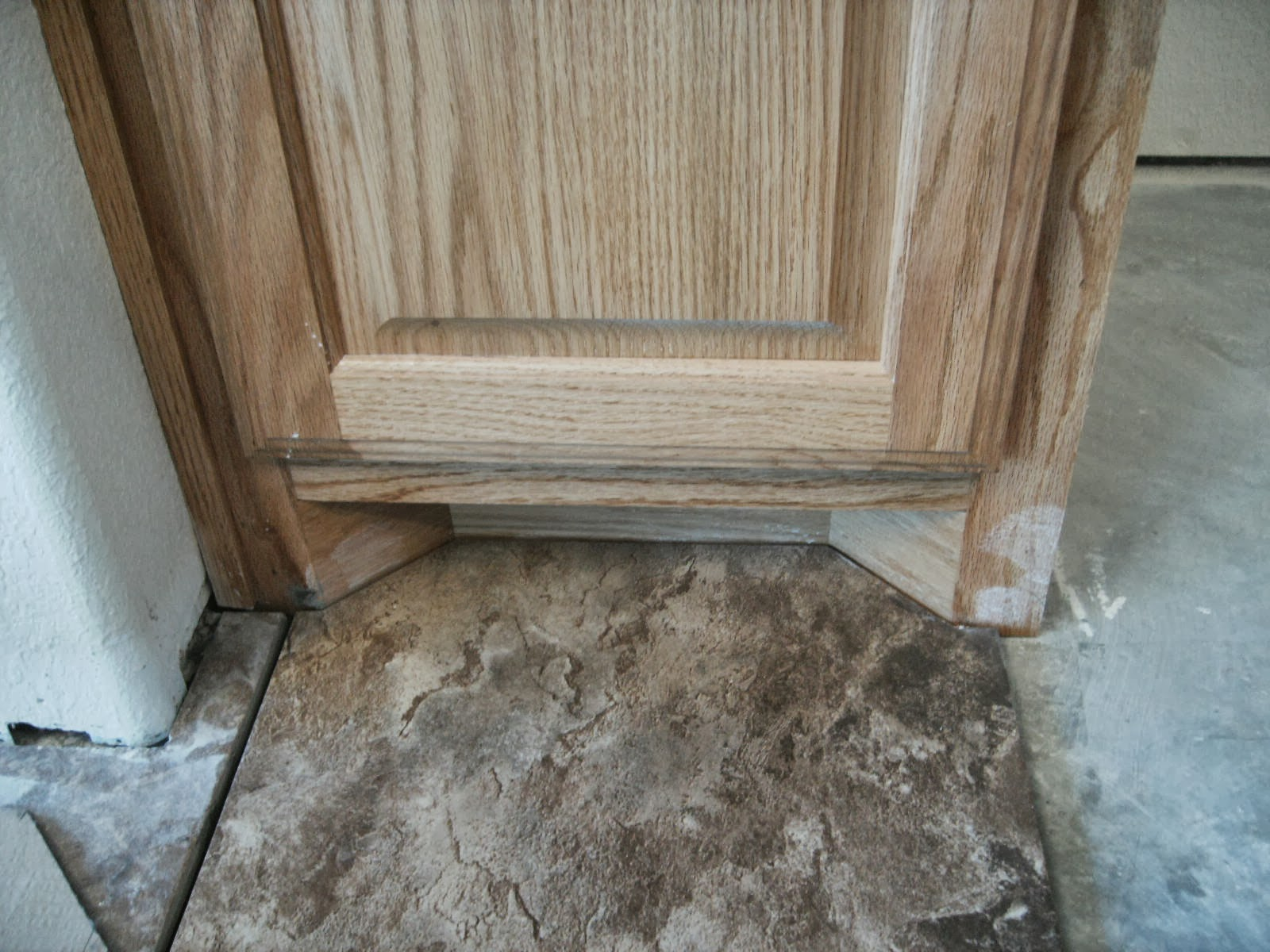 Tech tip how to make complex tile cuts confessions of a tile setter even if you undercut the jambs you still may have to remove the door trim this happens frequently when installing laminate flooring dailygadgetfo Gallery