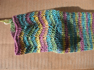 pretty teal, green, yellow, and purple ripples at the top of a sock