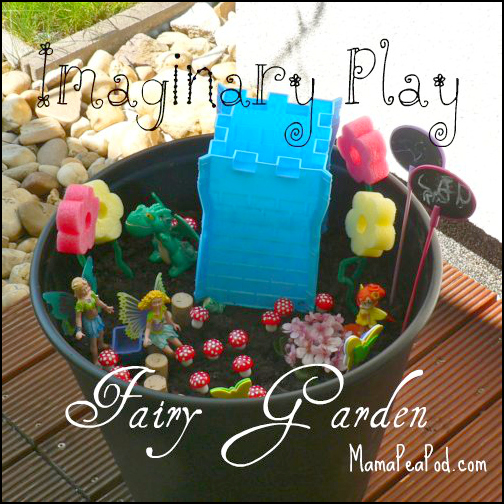 imaginary play fairy garden with castle, fairies, flowers, dragon, stepping stones and toadstools