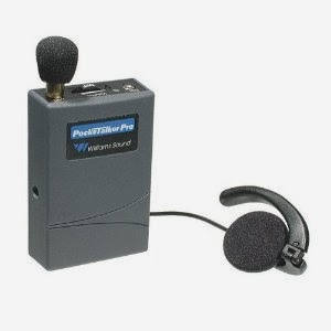 picture of a pocketalker - a grey box about the size of a deck of cards with a small mic and an earpiece