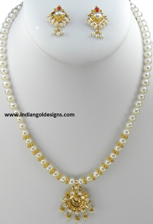 Gold and diamond jewellery designs pearls necklace attached to pearls necklace attached to gold pendant and earrings mozeypictures Image collections