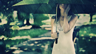Girl-in-rain-with-umbrella-waiting-for-love-boyfriend-image.jpg