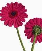 http://translate.google.es/translate?hl=es&sl=en&u=http://www.oddknit.com/patterns/flowers/gerberas.html&prev=search