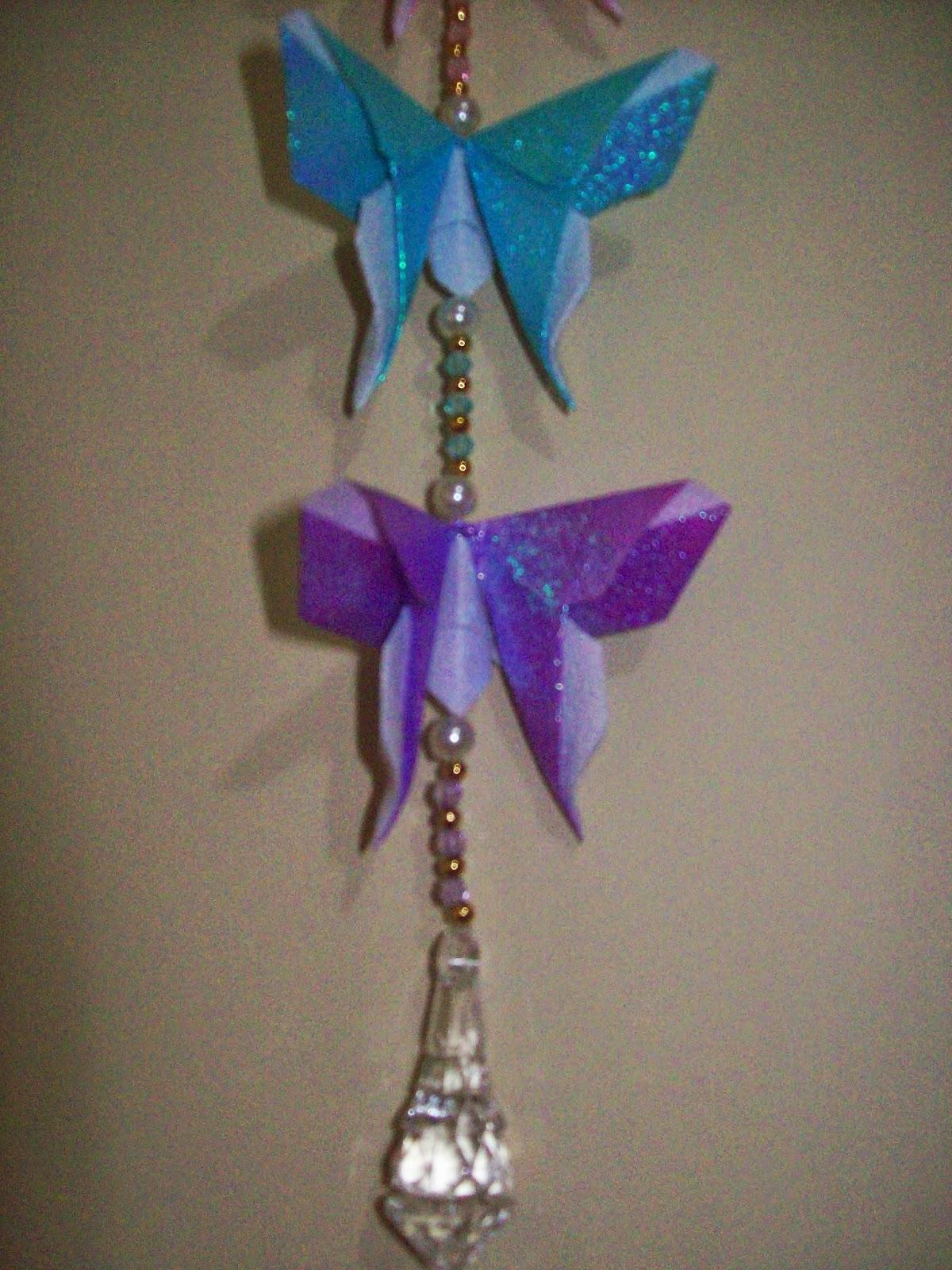 Borboletas Origami - uma azul claro e outra roxa