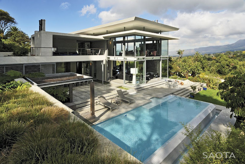 Picture of modern villa with the pool as seen from the hill right next  title=