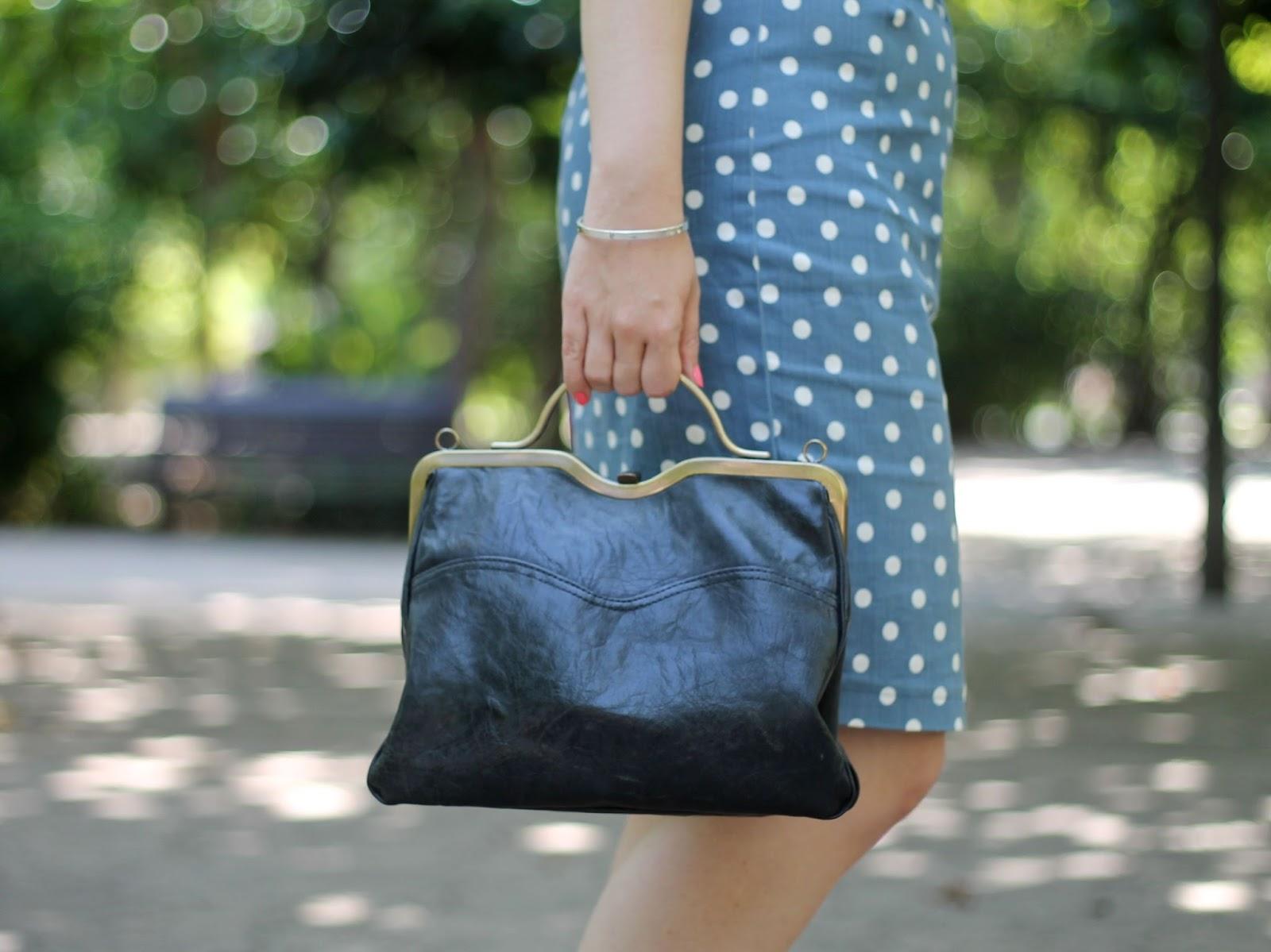Black frame bag and polka dot pencil skirt