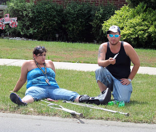sexy sitting at parade, in grass, spread legs