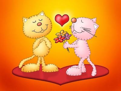 Gatitos enamorados sobre un corazón