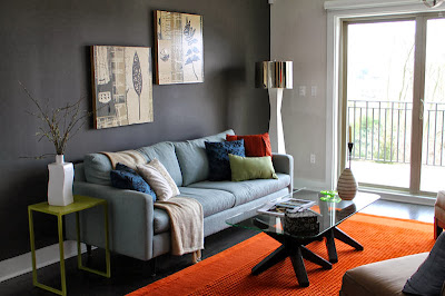 cool and stylish living room with artistic details and vibrant pops of color