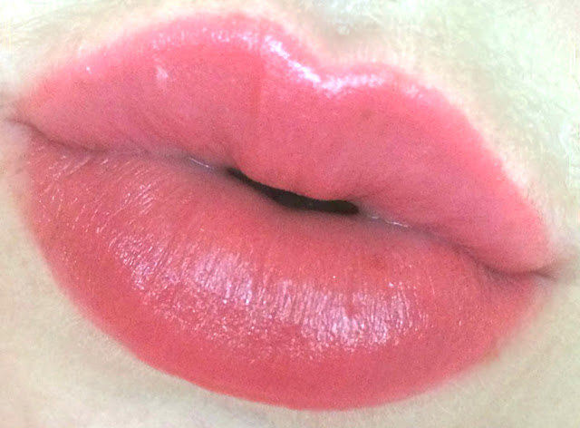 Too Faced Lip Injection Color Bomb! in Coral Pop! on lips