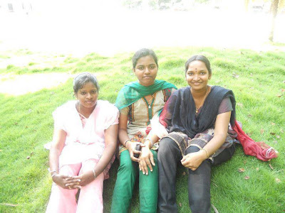 Tamil Nadu college girls sitting on lawn in-front of their college.