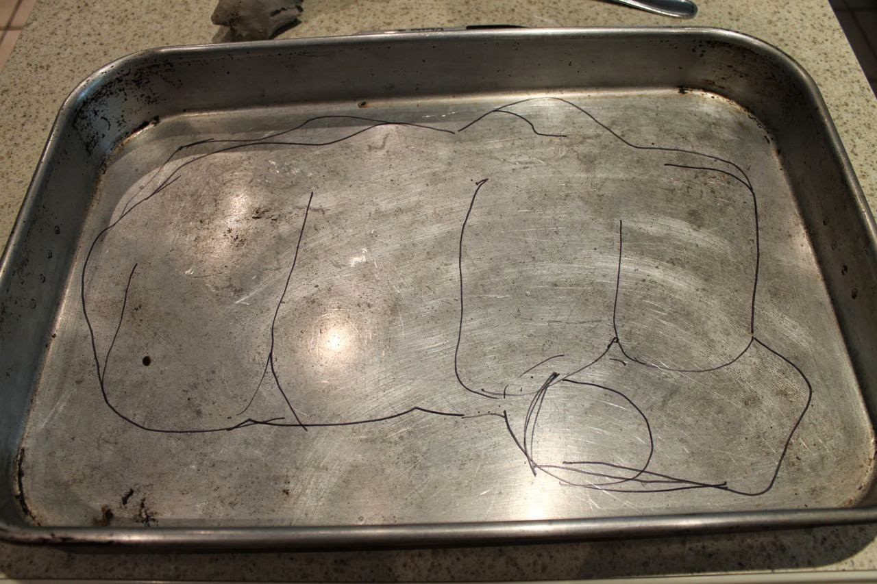 bro fist shape sketched in the bottom of baking pan