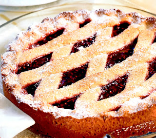 Linzer tart: chocolate and nut sponge cake where the top of the cake is filed with raspberry jam and covered with a pastry lattice before being baked in the oven
