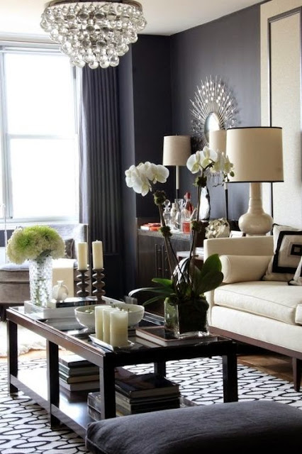 black living room walls robert abbey crystal chandelier white sofa sunburst mirror